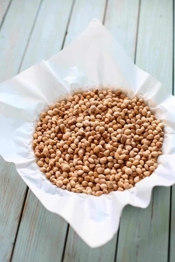 Fill parchment lined tart shell with beans to blind-bake