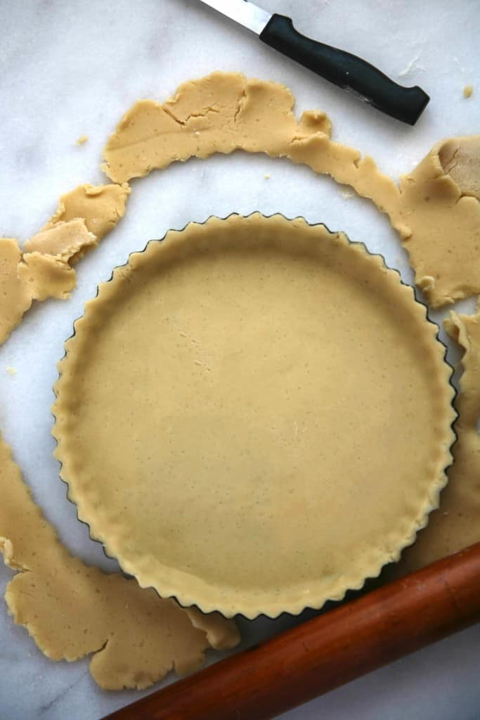 Gently fit sweet pastry into tart pan