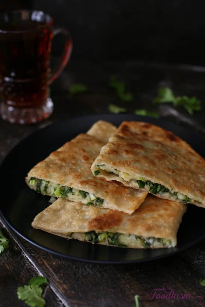 Afghani Bolani - Homemade flatbreads stuffed with potatoes, green onion, cilantro, and green pepper then shallow fried to crispy, golden brown perfection!