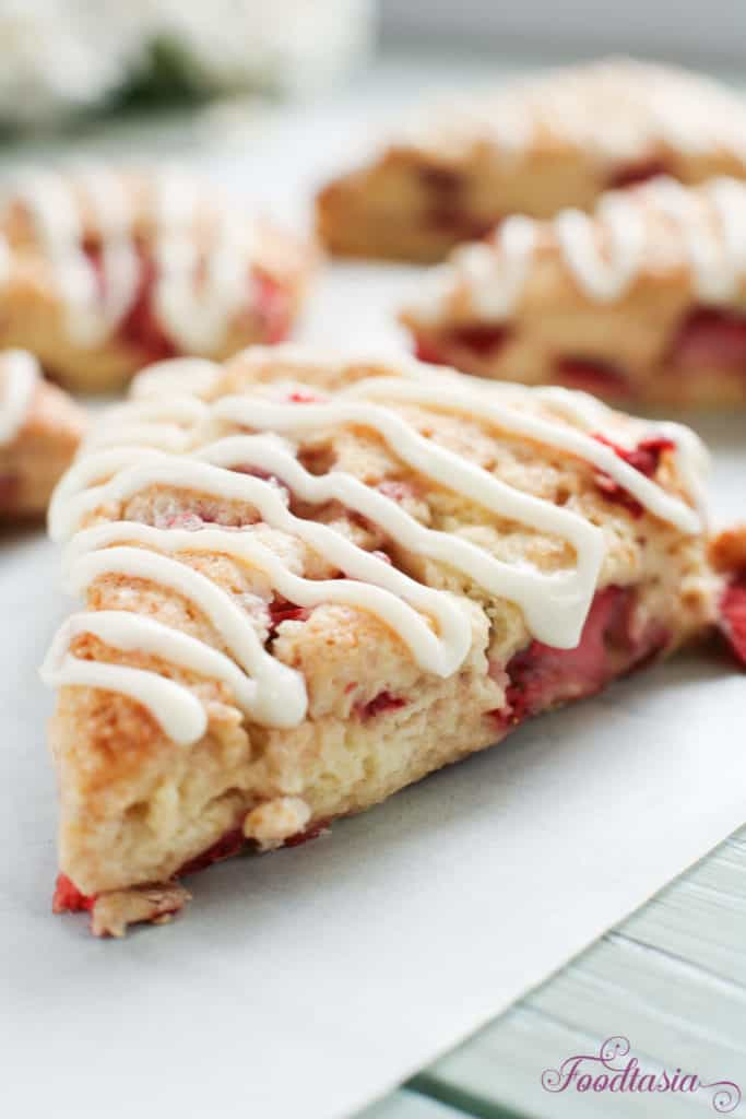 Bursting with fresh, juicy strawberries, these Strawberries and Cream Scones with Cream Cheese Glaze are perfect for breakfast or afternoon tea!