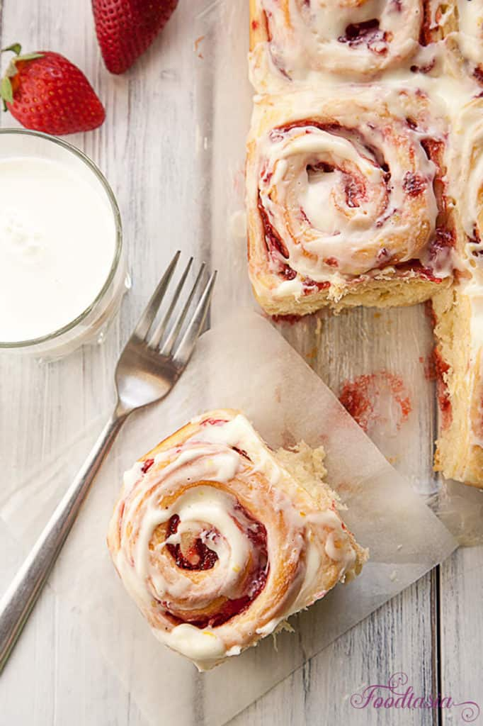 A soft, tender roll enveloping a sweet and tangy fresh strawberry swirl, topped with a cream cheese glaze with a hint of lemony citrus. Fresh Strawberry Sweet Rolls with a Lemony Cream Cheese Glaze make a delightful breakfast.