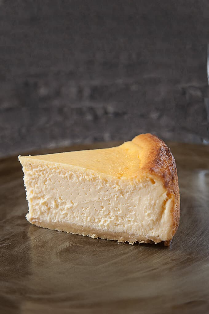 Classic New York Cheesecake is a heavenly cloud of silky perfection. Rich, creamy, and ethereally light, this tall and proud cheesecake is crowned with stunning browned edges and sits atop a buttery, crunchy shortbread crust.