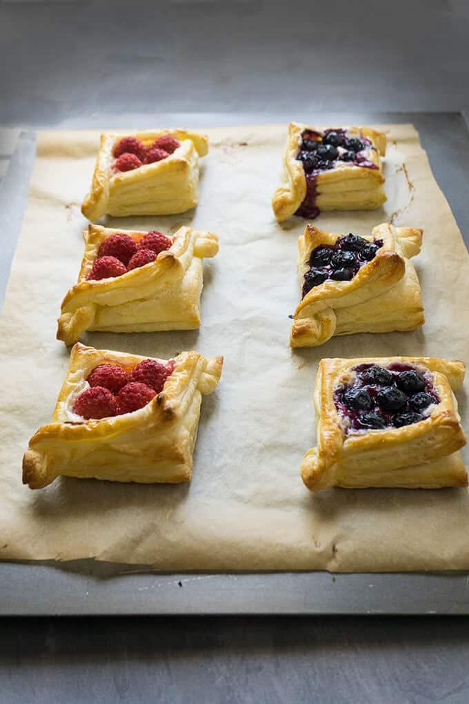 There are so many different textures going on in these pastries: buttery, flaky layers that are so light and airy with crispy, crunchy edges. Tart, juicy berries nestled in a rich, creamy, sweet filling. Each bite is delightful!