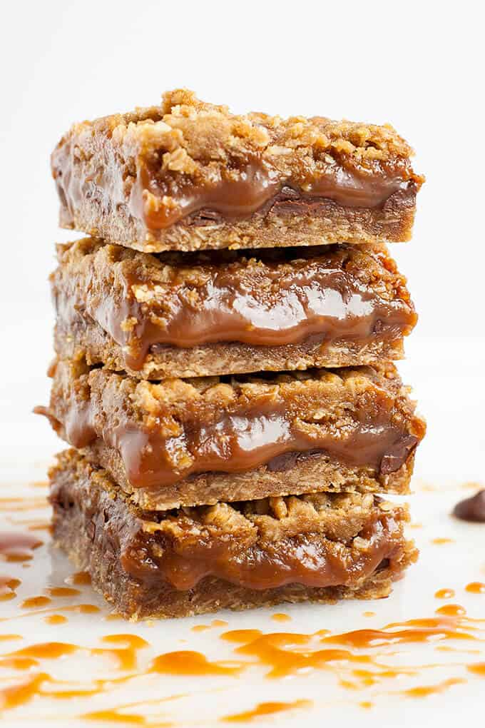 Chewy, gooey Salted Caramel Oatmeal Carmelitas - pockets of gooey, salted caramel oozing out from in between chunks of chocolate and crunchy pecans, all nestled in a brown sugar, oatmeal cookie crust and topped with an oatmeal streusel topping - Caramel Euphoria!