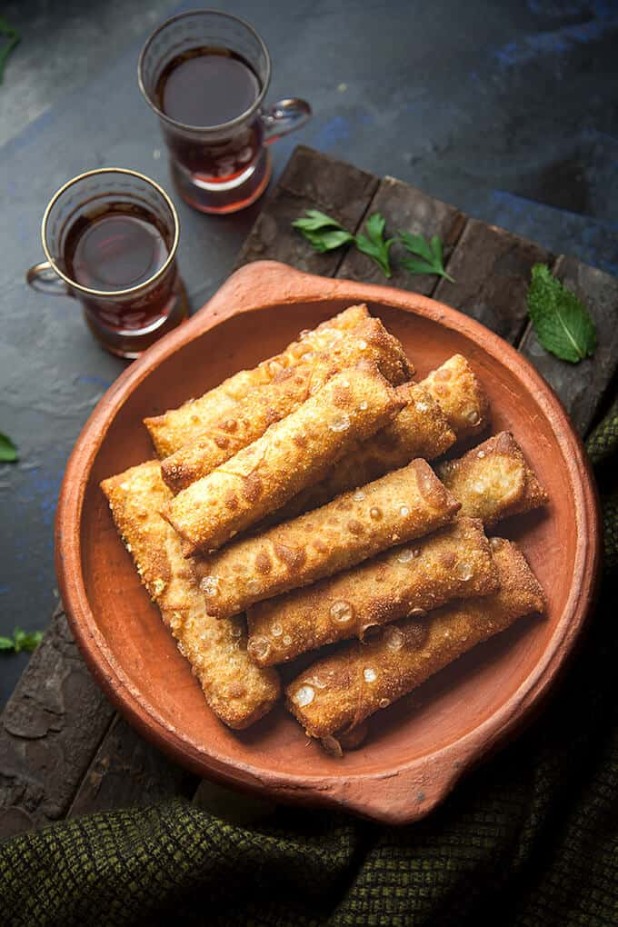 Cheese Sambousek - Crispy, chewy Middle Eastern cheese rolls filled with herbed Egyptian white cheese and mozzarella.