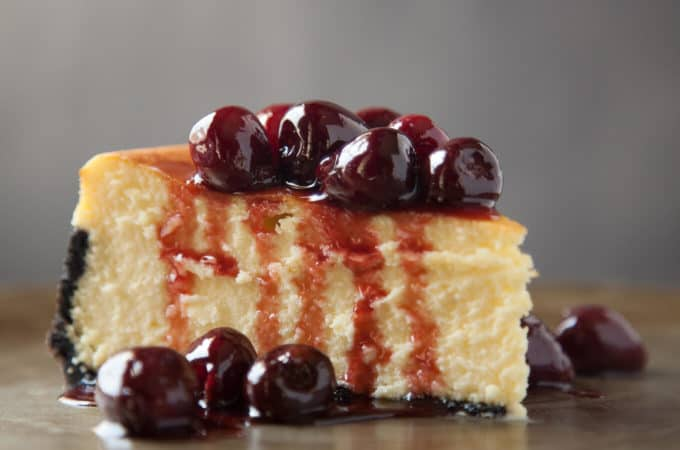Classic New York Cheesecake with a Chocolate Cookie Crust and Roasted Cherries
