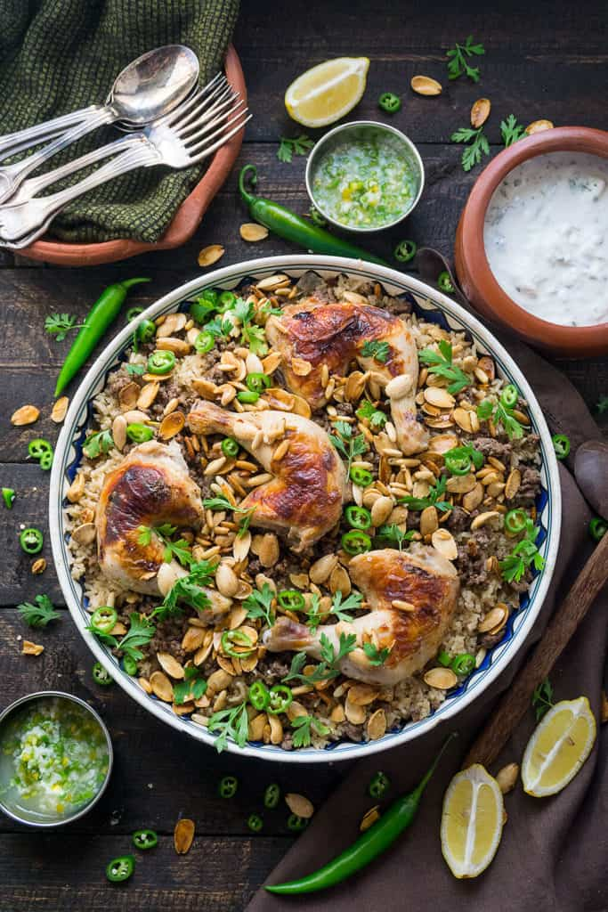 Middle Eastern Chicken and Rice Fattah is a glorious dishwith ariot of textures and flavors. A layered dish of saj bread, aromatic rice, fragrant spiced meat, crunchy nuts, juicy chicken, a garlicky chili sauce, and a cool minty yogurt sauce.