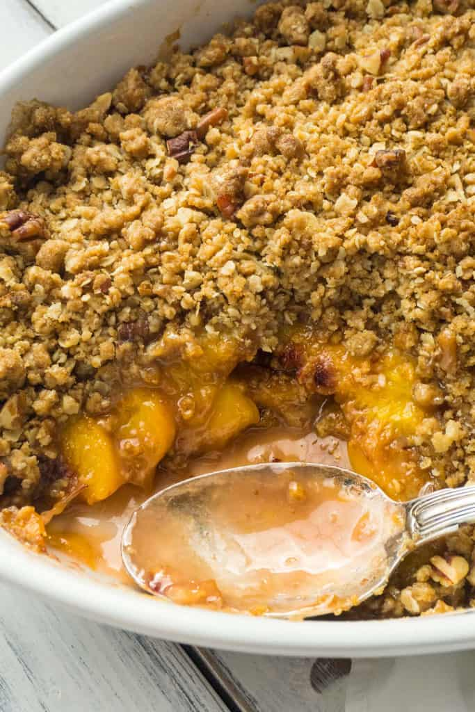 This Peach Crisp is wonderfully delicious with slices of fragrant, juicy, ripe peaches and a crunchy, sweet topping of brown sugar, oatmeal, and pecans