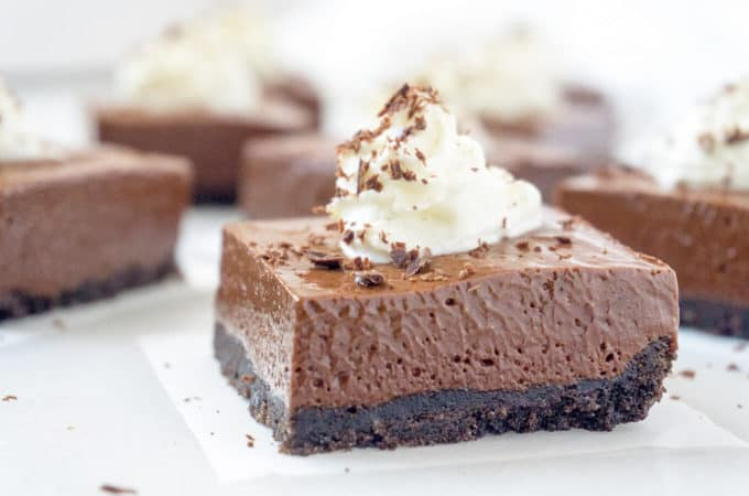 These Dreamy French Silk Pie Bars have a luxuriously dense, mousse-like filling that is incredibly rich and silky smooth with an Oreo cookie crumb crust.