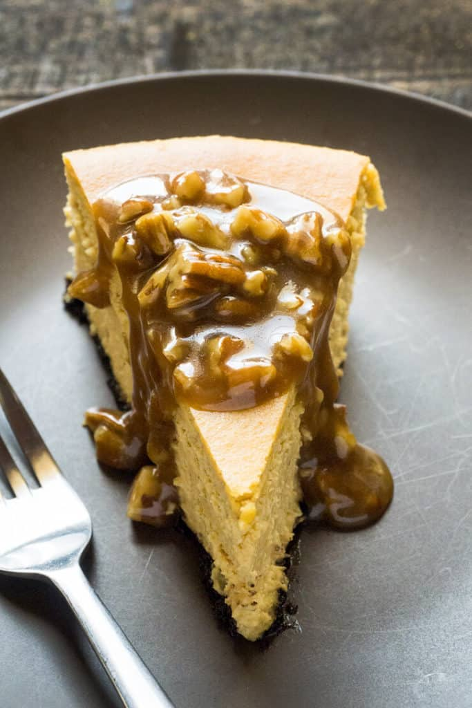 This tall and proud Pumpkin Cheesecake with Pecan Praline Sauce is delicately spiced and fabulously creamy. A fall and Thanksgiving favorite!