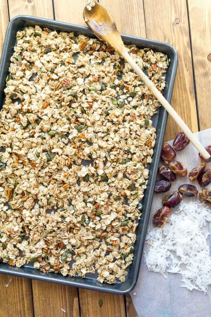 Maple Pecan Pumpkin Spice Granola - Crunchy clusters of maple sweetened granola with whole rolled oats, pecans, dates, pepitas, coconut, and warm pumpkin spice.