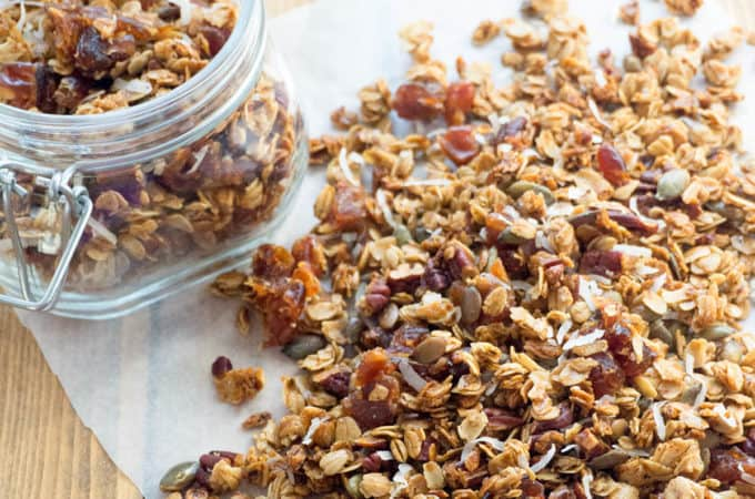 Pumpkin Spice Granola - Crunchy clusters of maple sweetened granola with whole rolled oats, pecans, dates, pepitas, coconut and warm pumpkin spice. Healthy, delicious, and so easy to make!
