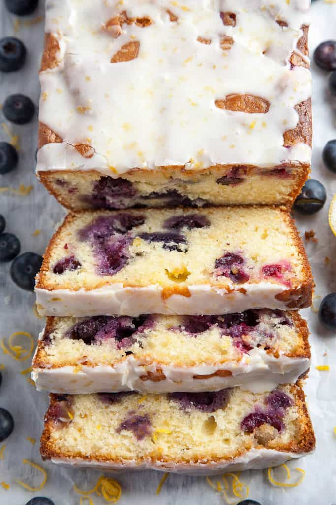 Double Glazed Blueberry Lemon Pound Cake - A moist, tender pound cake, infused with the bright and sunny flavor of lemon, bursting with sweet juicy blueberries, and topped with two (2!) glazes - one vibrant and tangy, one creamy and sweet.