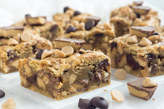 These Chunky, Chewy Peanut Butter Bars are so over the top! I packed in 18 (Eighteen!) full size Reese's peanut butter cups, peanut butter flavored chips, semi-sweet chocolate chips, and chunky peanut butter into a moist, chewy peanut butter bar. Extravagant? Definitely! But so delicious!