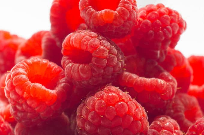 These DIY Oven Dried Raspberries are perfect for baking, granola, trail-mixes, and cereals. Grind them up into a powder to use when you want real raspberry flavor and color but not the liquid - think raspberry frosting! But the best reason to make these DIY Oven Dried Raspberries is White Chocolate Raspberry Cookies!