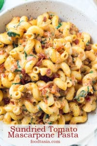 A family favorite, this Sundried Tomato Mascarpone Pasta with Baby Spinach and Roasted Red Pepper is loaded with veggies and has perfectly balanced flavors. Added bonus - it's super fast and easy to make! #pasta #quick #quickandeasy #quickdinner #easyrecipe #recipe #easydinner #weeknightdinner #weeknightmeals