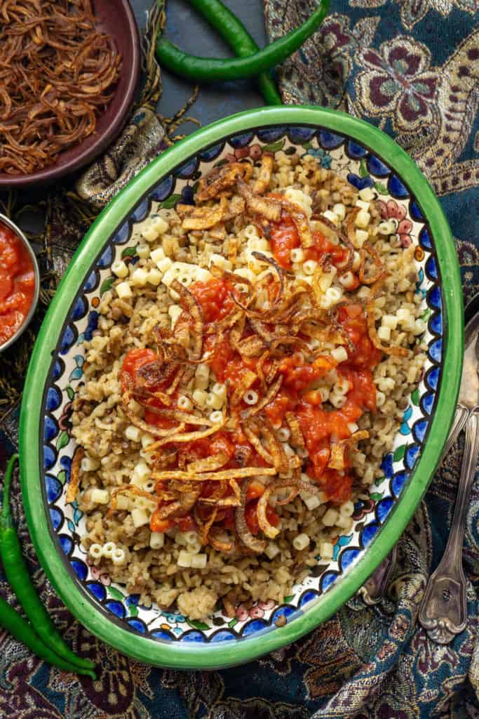 Kushari egyptian rice lentils and pasta with spicy tomato sauce kushari is egyptian comfort food at its finest with cumin scented lentils and rice topped forumfinder Image collections
