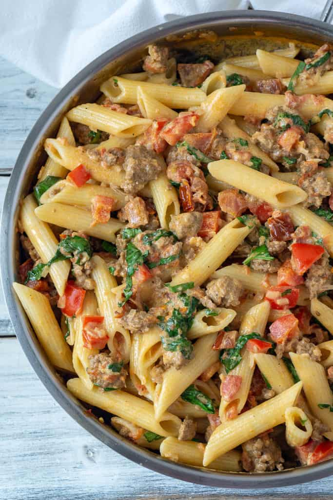 Italian sausage, sundried tomatoes, and red pepper in a creamy, cheesy sauce, this Creamy Italian Sausage and Tomato Pasta is quick and easy, and it tastes amazing. It's sure to be your new go-to dinner on busy weeknights. A family favorite!