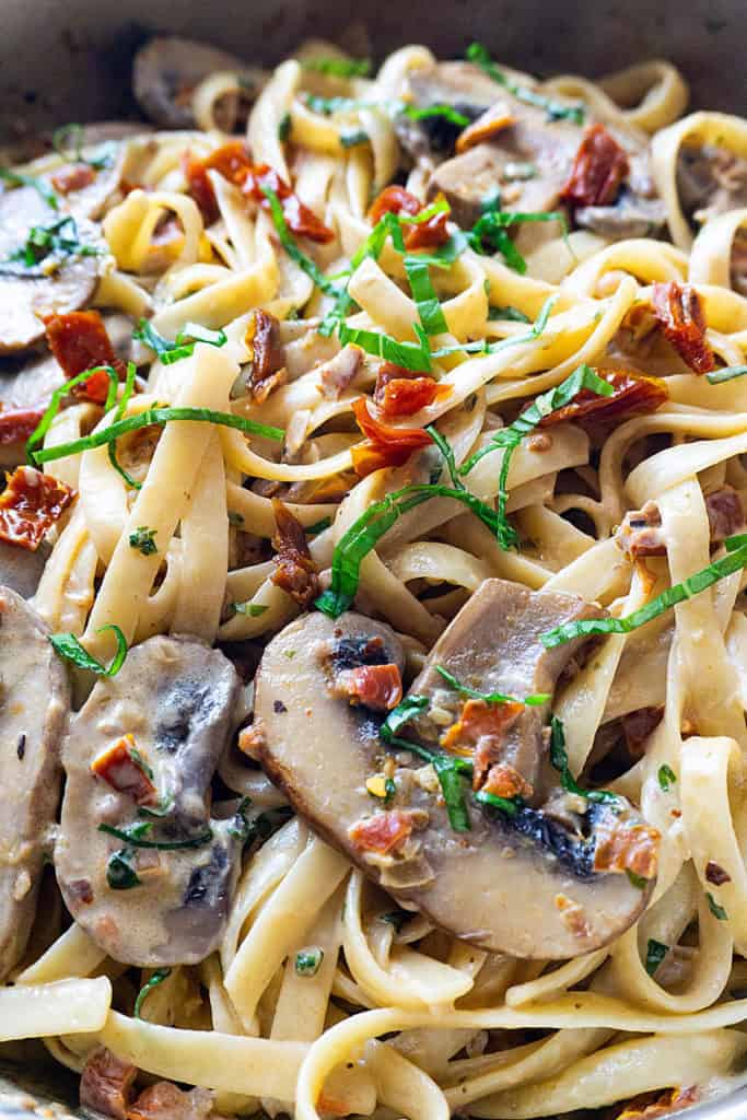 Pasta tossed with sun-dried tomatoes and sautéed mushrooms in a creamy, cheesy sauce fragrant with garlic and basil, this Sun-Dried Tomato and Mushroom Pasta is sure to become a family favorite. Quick and easy to make, it's perfect for a weeknight dinner.