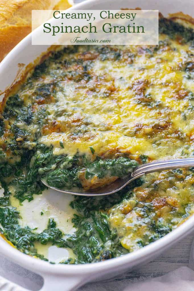 This Creamy, Cheesy Spinach Gratin is full-on flavor! Fresh spinach in a creamy, cheesy sauce baked until bubbly and golden. You won't believe it's light and healthy with no cream. The whole family agrees – it's the best spinach we've ever eaten.