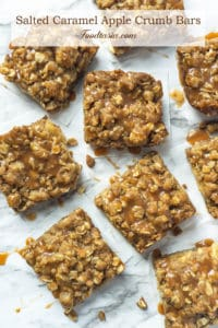 These Salted Caramel Apple Crumb Bars have slices of juicy apples drizzled with caramel, sandwiched in between the BEST brown sugar oat crust and streusel topping. One bowl and so easy to make. Same dough for crust and topping - it's moist, it's crunchy, and it has the most amazing buttery, caramel flavor