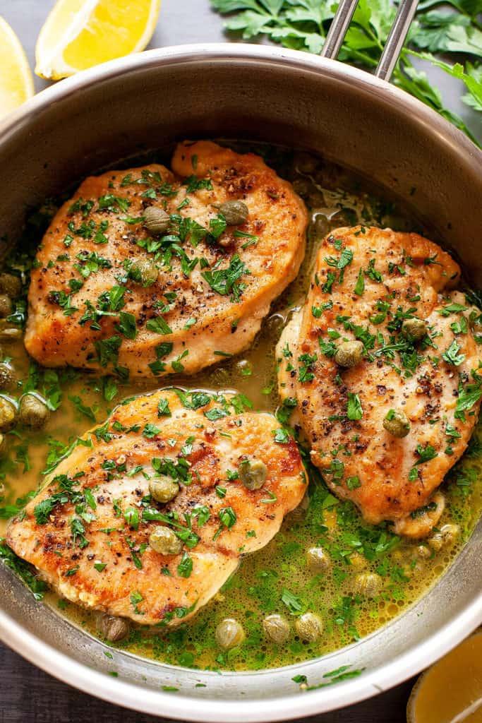 Sautéed chicken breasts in a buttery lemon, caper, and parsley sauce, this Lemon Caper Chicken is one of my most popular recipes. Super fast and easy to make, it's one of those rare, winning dishes that everyone in the family loves. Start to finish in 15 minutes - you'll definitely want to add it to your weekly rotation!
