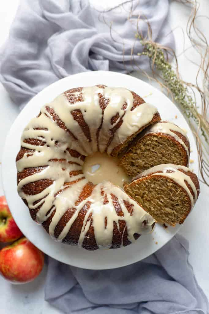 This Triple Glazed Caramel Apple Cider Cake is bursting with apple and the flavors of autumn! Shredded apples and an intense apple cider syrup flavor the moist, tender cake. Three glazes send it right over the top - an apple cider syrup glaze, an apple cider icing, and a caramel drizzle. #applecake #applecidercake #apple #applecider #falldesserts #desserts #dessertrecipes #recipe #easy #caramel #cake #bundt #easydessert #dessertfoodrecipes #easyrecipes #cakerecipes #bundtbakers #bundtcake