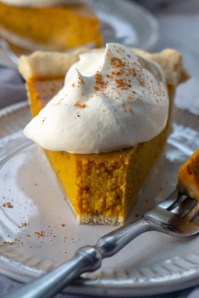Winner of the Pumpkin Pie Challenge. Discover the secret to the Best Pumpkin Pie Recipe that's ultra-silky smooth with the deepest, richest pumpkin flavor. #pumpkin #pumpkinrecipes #pumpkinspice #thanksgiving #thanksgivingrecipes #falldesserts
