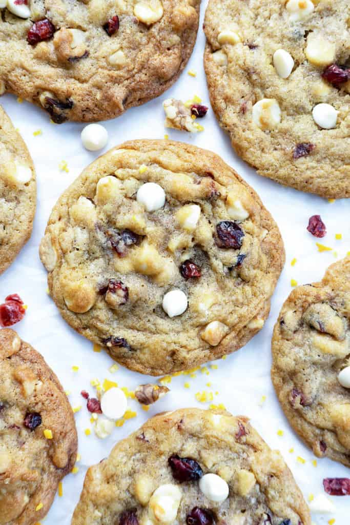 With crisp, caramelized edges and rich, chewy centers, these White Chocolate Cranberry Cookies are irresistible! Recipe from Foodtasia. #cookies #cookierecipes #recipes #whitechocolate #whitechocolatechipcookies #whitechocolatecookies #cranberry #cranberryrecipe #cranberryorangecookie #holidayrecipes #holidaydesserts #holidaycookies