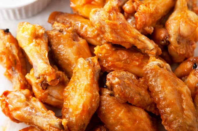 These easy Baked Chicken Wings are amazingly crispy and crunchy. With a surprise ingredient that you probably have on hand and a simple technique, you can have Super Crispy Baked Chicken Wings with minimal effort. #wings #chickenwings #bakedwings #bakedchickenwings #recipe #easyrecipe #appetizers #appetizerrecipes #appetizerseasy #appetizersforparty #gamedayrecipes #gamedayfood