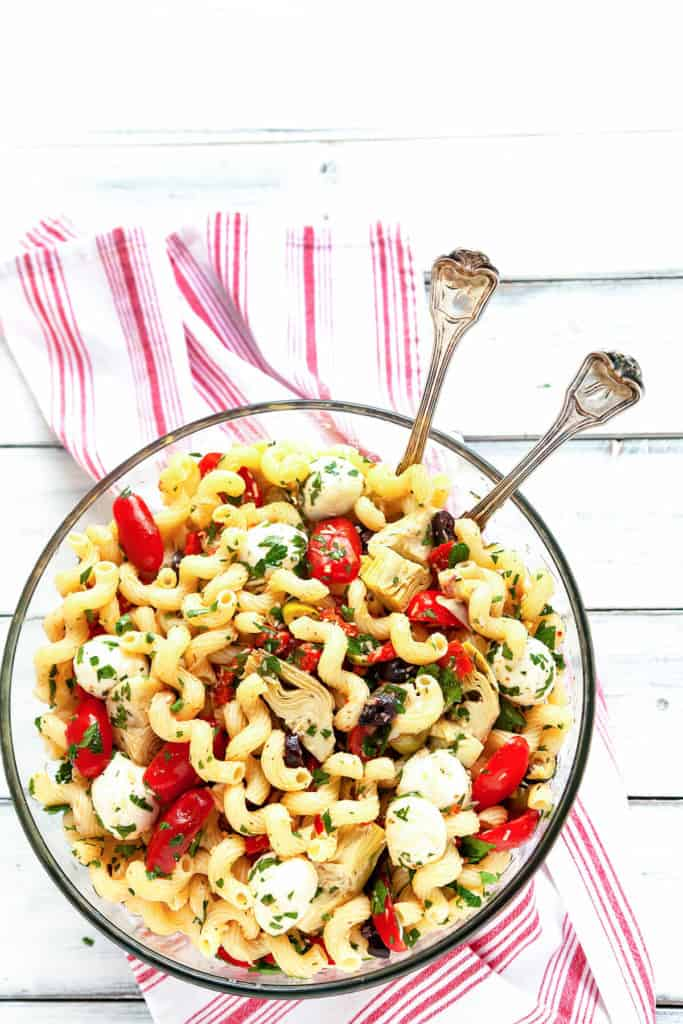 Everyone loves this Easy Italian Antipasto Pasta Salad! It's filled with the delicious flavors of your favorite Italian antipasto tossed with a homemade dressing. My go-to recipe for a quick meal, picnic, or potluck. #pasta #salad #Italian #antipasto #artichoke #marinated #redpepper #picnic #potluck #easy #quick #recipe #dinner