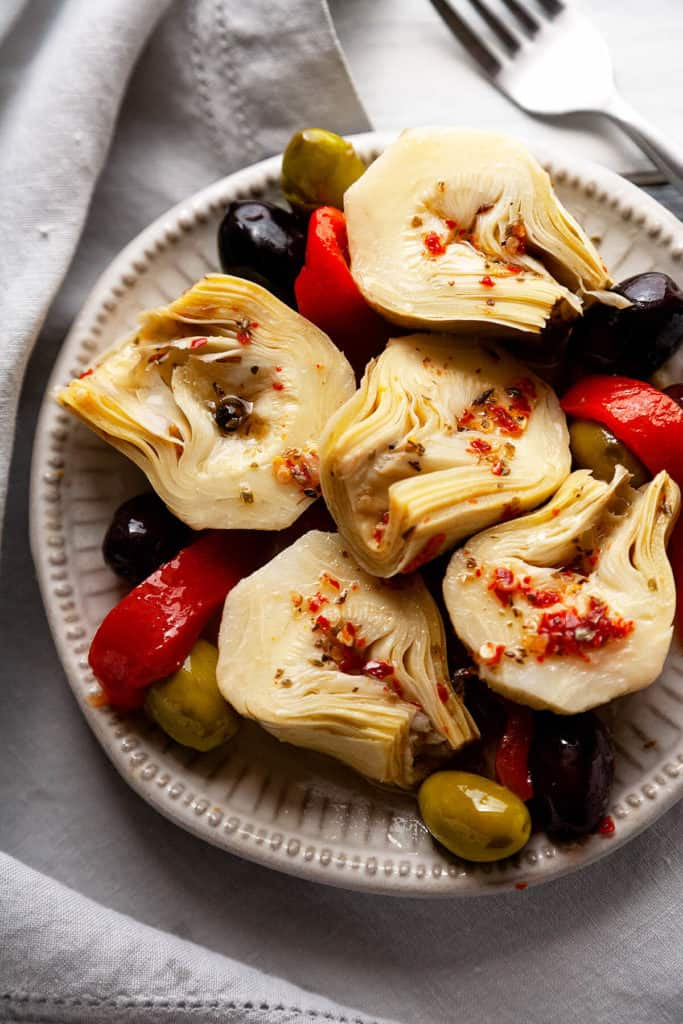 Ready in 5 minutes! You won't believe how easy and how delicious these Easy Marinated Artichoke Hearts are! #artichokes #artichokehearts #marinated #italian #recipe #appetizer #antipasto #salad #food #easy #quick #homemade #5minute