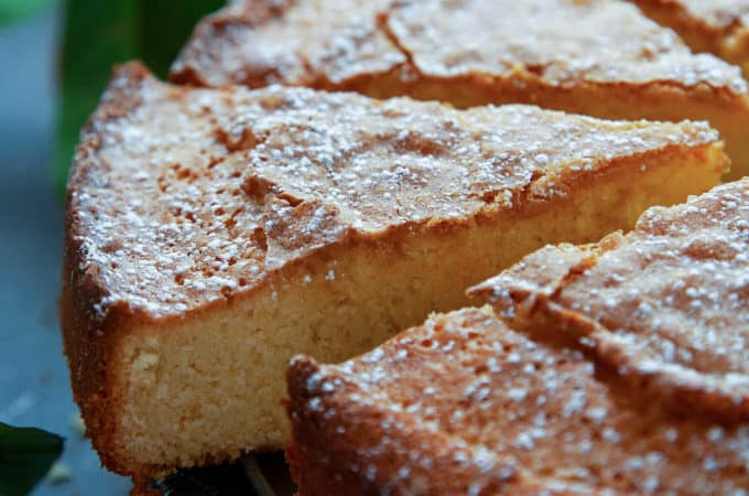 This Orange Olive Oil Cake is so tender, so light, and so moist with a lovely hint of orange and a rustic, crackly topping. It's sure to become a family favorite! #oliveoilcake #orangecake #olive oil #orange #cake #easy #moist #italian #citrus #moist #best #recipe #fromscratch #homemade #topping #dessert #cooksillustrated