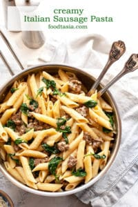 Creamy Italian Sausage Pasta - pasta with sausage and spinach in the creamiest, garlicky parmesan sauce. Pure comfort food on the table in under 30 minutes! #pasta #recipe #easy #quick #under30minutes #easydinner #easyrecipes #sausage #creamy #weeknight #datenight