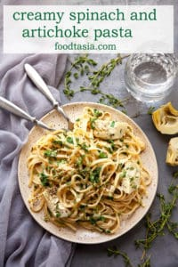 Creamy Spinach Artichoke Pasta - hot buttered pasta tossed with spinach and artichokes in a creamy, garlicky, parmesan sauce. Simple, yet elegant. Perfect for date night or a quick weeknight dinner. Ready in under 30 minutes. #pasta #dinner #easy #recipe #artichoke #spinach #under30minutes #quick #weeknight