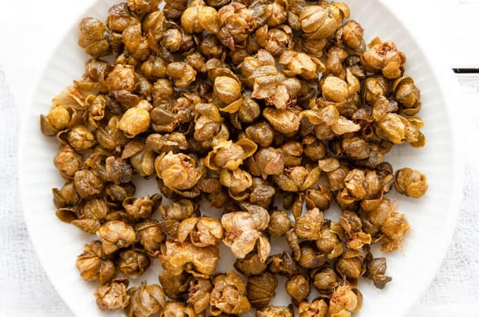 Crispy, nutty, and briny, Fried Capers are magical little flavor bombs that add an incredible dimension of flavor and texture to salads, pasta, meat, and vegetable dishes. #garnish #italian #recipe #easy #quick #flavor #fried #whatare #howtouse