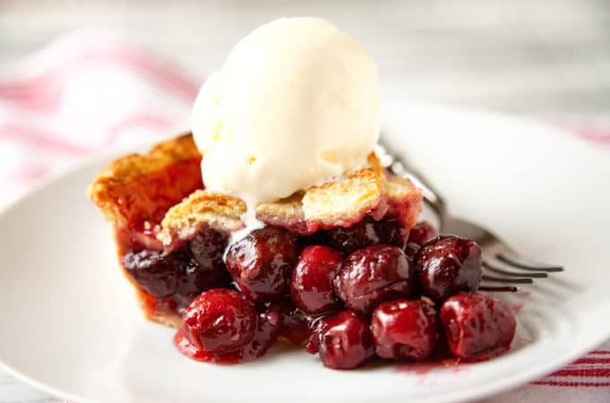 Homemade Cherry Pie is a summertime classic with its buttery, flaky crust and a beautiful, juicy cherry filling #cherry #pie #easy #lattice #tapioca #cornstarch #best #tart #sweet #homemade #fresh #recipe #fromscratch #bing