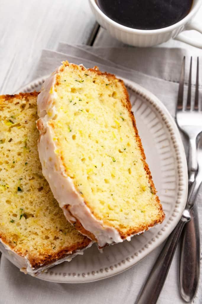 The Best Ever Double Glazed Lemon Zucchini Bread is light, tender, and ultra-moist. Two glazes for a burst of sweet lemon flavor! #zucchini #bread #best #easy #quick #recipe #lemon #moist #withbutter
