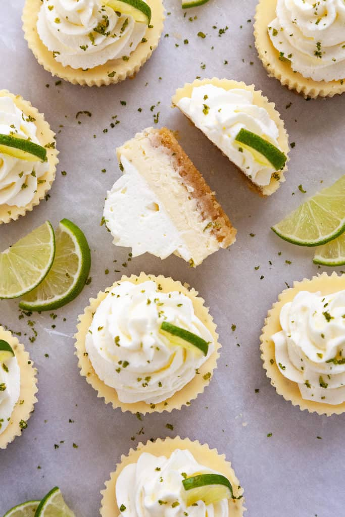 These Mini Key Lime Cheesecakes are the perfect combination of creamy, tart, and sweet in the cutest little cakes. Quick and easy to make using a muffin pan and paper liners. #cheesecake #mini #keylime #lime #dessert #recipe #easy #baked