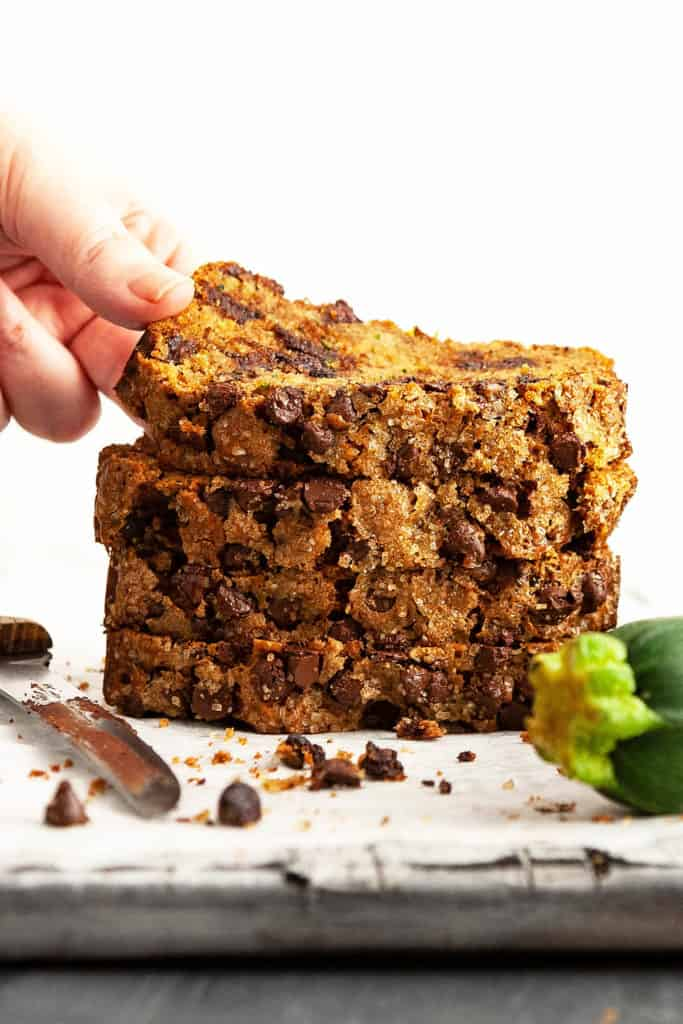 Chocolate Chip Zucchini Bread – elevating a summertime favorite to a whole new level! Super moist and tender, dotted with chocolate chips, and a crispy, crackly sugar-coated top. #zucchini #bread #recipe #chocolatechip #easy #quick #oneloaf #best #simple #moist #withbutter