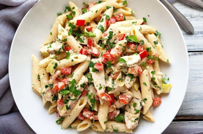 This Creamy Lemon Artichoke Pasta with Chicken, red peppers, and parsley has a bright, delicate lemon flavor in a creamy, garlicky parmesan sauce. An easy and flavorful one dish meal. Restaurant quality in under 30 minutes. #pasta #artichoke #quick #easy #chicken #dinner #creamy #redpepper #lemon #under30minutes #datenight