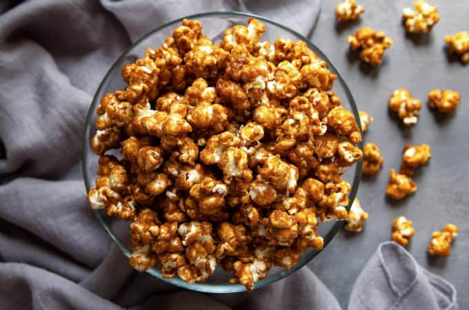 The ultimate easy, Homemade Caramel Corn recipe. Easy to make, stays crispy and crunchy for weeks, and you won't believe how addictive it is! Perfect for parties, snacking, movie night, and gifting. #caramelcorn #caramelpopcorn #caramel #popcorn #snacks #party #food #recipe #homemade #easy #gift #movienight #video #crunchy