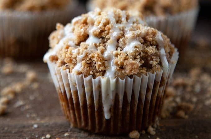 Pumpkin Streusel Muffins – a light, tender pumpkin muffin topped with the most amazing buttery, brown sugar, pumpkin spice streusel and an easy vanilla glaze. #muffins #pumpkin #streusel #crumb #quick #easy #from scratch #recipe #breakfast #cake #snack #bakery style #video