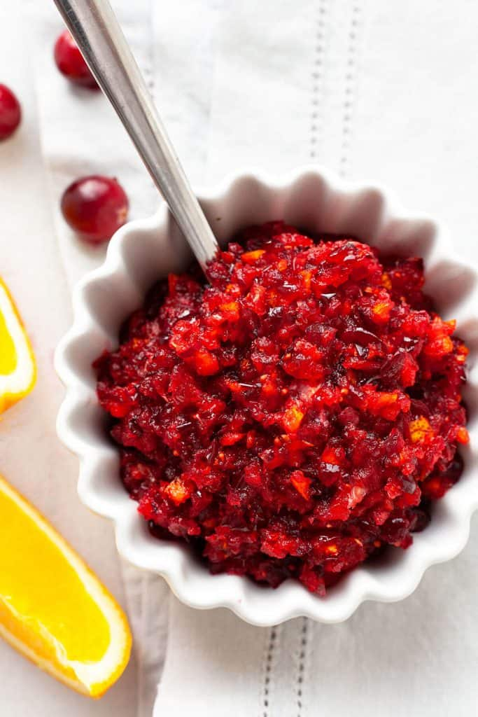 This easy Cranberry Orange Relish is fresh, vibrant, and easy to make with only three ingredients! A must-have for our holiday meals! #cranberry #relish #orange #sauce #Thanksgiving #easy #quick #fresh #recipe