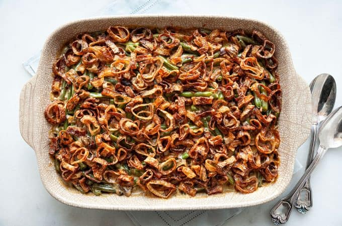 Classic Green Bean Casserole with tender green beans smothered in a creamy mushroom sauce topped with crispy fried shallots, all from scratch. A classic, Thanksgiving must-have recipe! #green bean casserole #Thanksgiving #holiday #dinner #recipe #from scratch #homemade #best #fresh #classic #make ahead