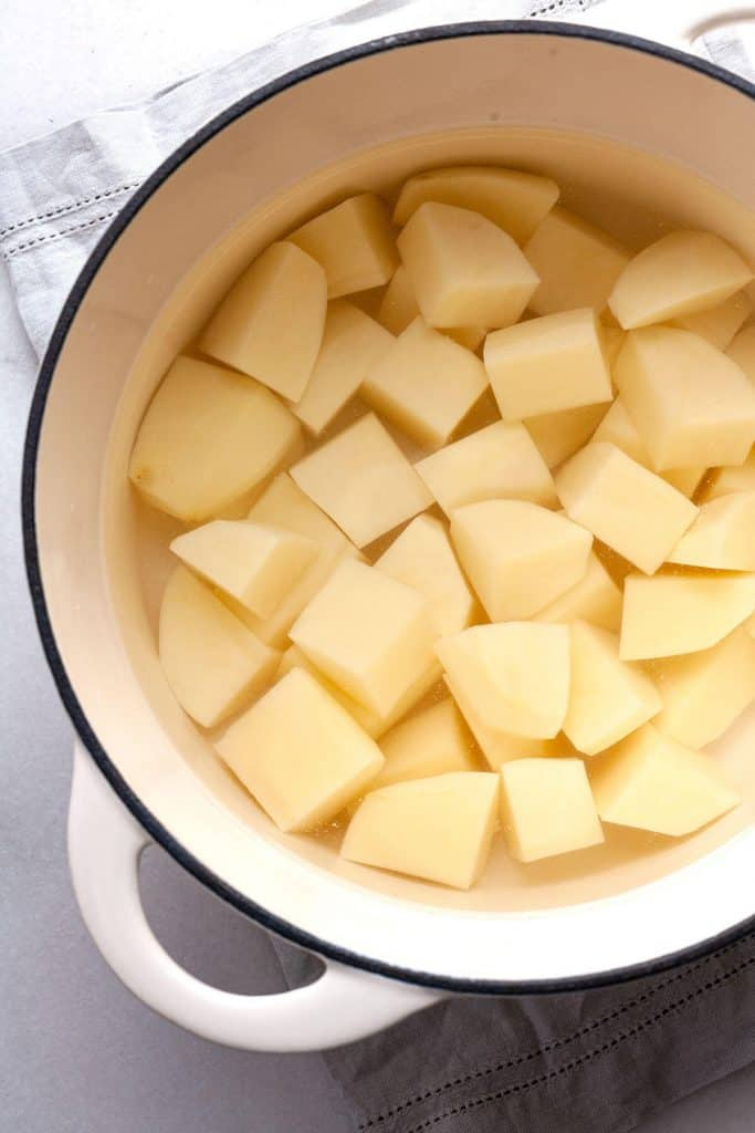 The BEST homemade Mashed Potatoes - deliciously rich and creamy, easy to make, and perfect every time. #easy #recipe #garlic #best #creamy #make ahead #Thanksgiving #homemade #russet #yukon gold #classic