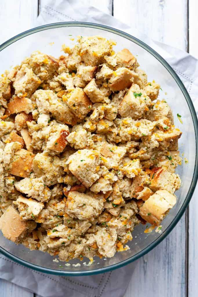 The Traditional Thanksgiving Classic Stuffing recipe that the whole family loves. A deliciously easy stuffing made with simple ingredients and incredible flavor. A tried and true family favorite. #stuffing #dressing #classic #traditional #Thanksgiving #old fashioned #oven #best #quick #easy #moist #homemade #bread #recipe #casserole