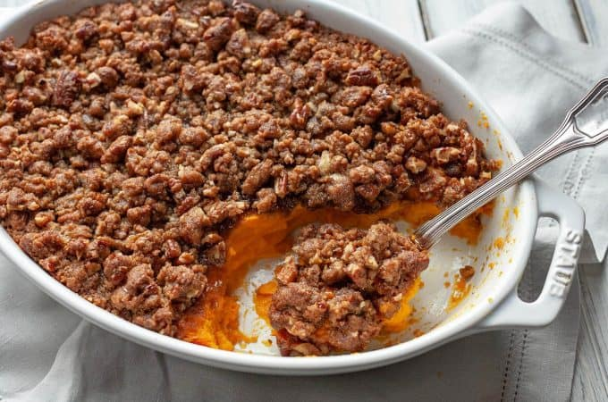 Sweet potato casserole - velvety smooth, sweet potatoes topped with the most amazing sweet, crunchy, pecan and brown sugar streusel. A must have on the Thanksgiving or holiday table. #sweet potatoes #casserole #dinner #Thanksgiving #holiday #from scratch #streusel #side dish #dessert
