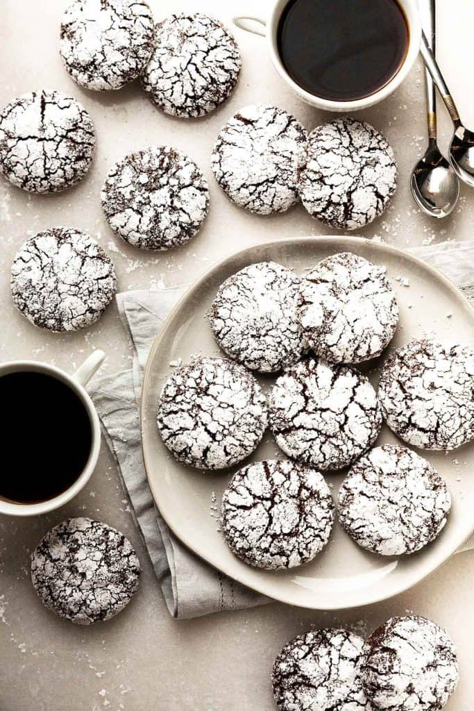 Rich and Fudgy Double Chocolate Crinkle Cookies are irresistibly soft, tender, and chewy. With a fudgy brownie interior and a cookie crunch on the outside. A classic holiday favorite! #crinkle cookie #earthquake cookie #chocolate #cookies #holiday #christmas #best #from scratch #recipe #homemade #easy