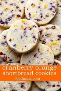 Cranberry Orange Cookies - a tender, buttery shortbread slice and bake cookie loaded with tangy cranberries and zingy orange. These easy-to-make cookies melt in your mouth! #cranberry #orange #cookies #holiday #shortbread #slice and bake #recipe #easy #melt in your mouth #best #buttery #traditional #cranberry orange #christmas